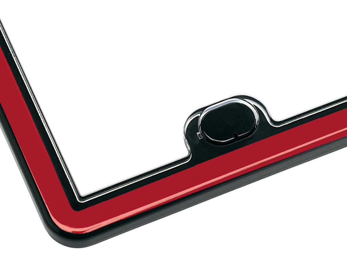 Close up of a red WeatherTech ClearFrame License Plate Frame.