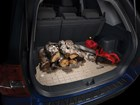 logs and chainsaw on a Cargo Liner BY WEATHERTECH
