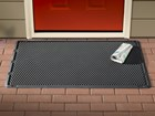 OutdoorMat in front of red door with newspaper BY WEATHERTECH
