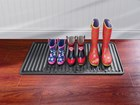 three pairs of wet rain boots on a black Boot Tray BY WEATHERTECH