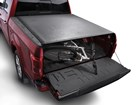 Bicycle in truck bed underneath bed cover. BY WEATHERTECH