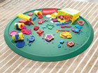 play doh on a green Christmas Tree Mat BY WEATHERTECH