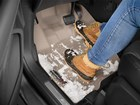 Snowy boots on a FloorLiner.  BY WEATHERTECH