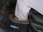 Men's shoes on a black FloorLiner.  BY WEATHERTECH