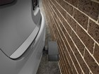 BumpStep installed on a vehicle by a brick wall. BY WEATHERTECH