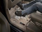 snow boots on a tan FloorLiner BY WEATHERTECH