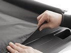 Man securing bed cover. BY WEATHERTECH