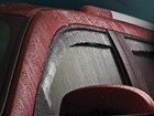 Side Window Deflector on red truck BY WEATHERTECH