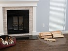 firewood on an All Purpose Mat next to fireplace BY WEATHERTECH