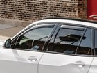 side view of white SUV with Side Window Deflector BY WEATHERTECH
