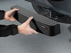 hands inserting BumpStep XL into vehicle BY WEATHERTECH