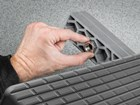 hand inserting the nuts for BumpStep XL BY WEATHERTECH