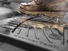 Black FloorLiner HP with muddy boot. BY WEATHERTECH