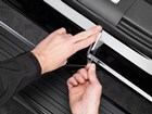 ScratchProtection being installed on door sills.  BY WEATHERTECH