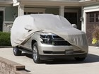 Outdoor Car Cover partially covering large SUV.  BY WEATHERTECH
