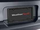 WeatherTech Carbon Fiber Plate Frame on vehicle.  BY WEATHERTECH