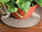 coaster underneath plant pot BY WEATHERTECH