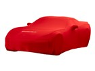 Red Indoor Car Cover on sports car.  BY WEATHERTECH