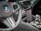 CupFone with mobile phone in BMW cup holder.  BY WEATHERTECH