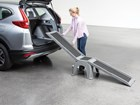 Woman attaching Easy Ramp to vehicle's trunk BY WEATHERTECH