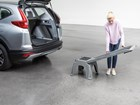 Woman dissembling an Easy Ramp to pack up BY WEATHERTECH