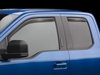 Side Window Deflector on a blue truck BY WEATHERTECH