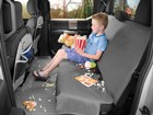 kid with popcorn sitting on a Seat Protector BY WEATHERTECH