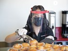 Service worker serving food with face shield. BY WEATHERTECH
