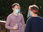 Men talking while wearing Face Shield Air. BY WEATHERTECH