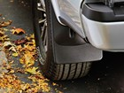 MudFlap shown on vehicle near tree leaves BY WEATHERTECH