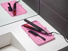 FlexTray with curling iron and brush on sink.  BY WEATHERTECH