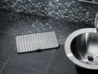 FlexTray in use as a bathroom liner. BY WEATHERTECH