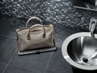 FlexTray protecting purse from bathroom sink. BY WEATHERTECH