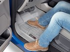 tan boots on a grey FloorLiner BY WEATHERTECH