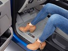 tan women boots on a grey FloorLiner BY WEATHERTECH