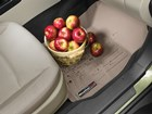 Bushel of apples on a tan FloorLiner. BY WEATHERTECH