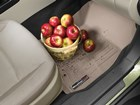Dirty and muddy bushel of apples on FlooLiner.  BY WEATHERTECH