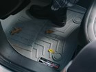 Gray FloorLiner with leaves and rain. BY WEATHERTECH