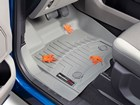Gray FloorLiner with fallen leaves.  BY WEATHERTECH