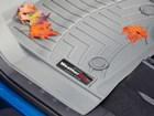 Closeup of fall leaves on a gray FloorLiner. BY WEATHERTECH