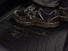 Floorliner_Muddy_Shoes BY WEATHERTECH