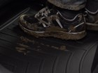 muddy tennis shoes on a FloorLiner BY WEATHERTECH