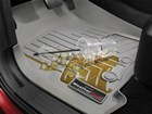 Iced coffee spilled on a gray FloorLiner. BY WEATHERTECH