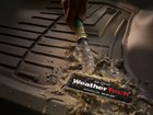 Cleaning a muddy FloorLiner.  BY WEATHERTECH
