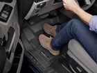 Suede shoes on a black driver side FloorLiner.  BY WEATHERTECH