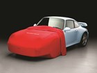 Red Indoor Car Cover partially on a Porsche. BY WEATHERTECH