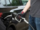 man using Fuel Glovet to pump gas BY WEATHERTECH