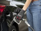 close up of woman using Fuel Glovet to pump gas BY WEATHERTECH