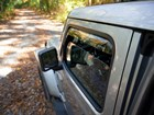 Side window deflectors on a Jeep near a trail. BY WEATHERTECH