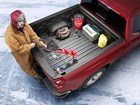 Man loading ice fishing tackle into truckbed. BY WEATHERTECH